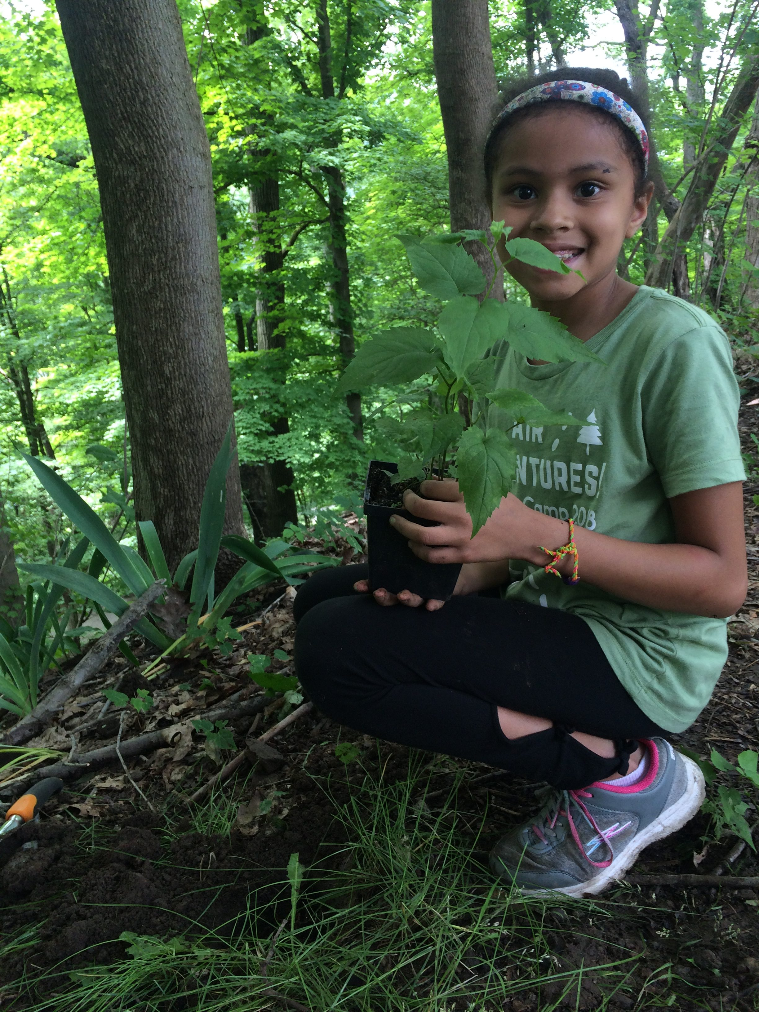 Air Adventures Summer Camp- campers plant native species to help improve air quality